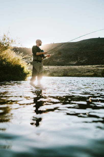 Man Fly Fishing On Deschutes River Rafting Trip stock photo