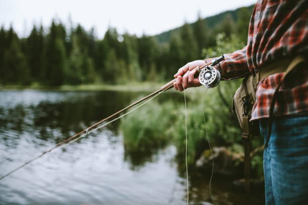 Mann Fliegenfischen  – Foto