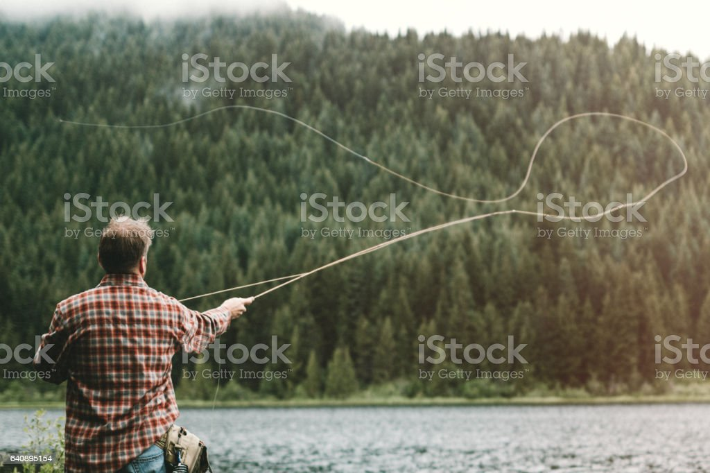 Man Fly Fishing stock photo