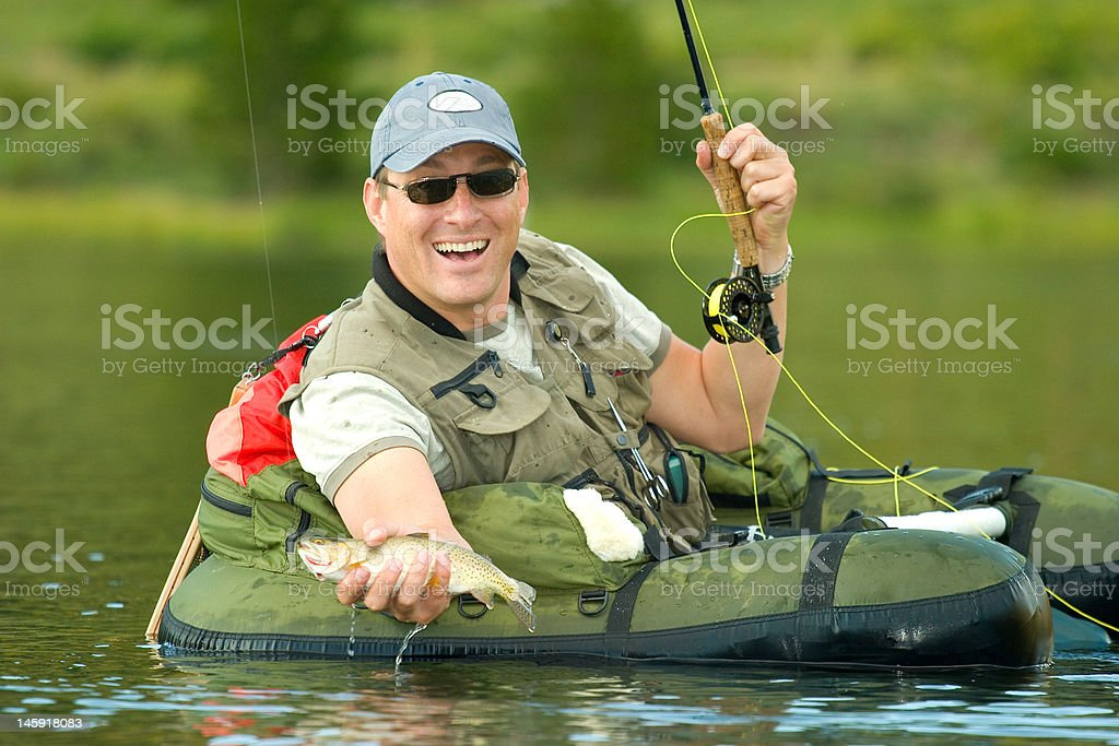 Man flyfishing for Greenback cutthroat trout in Colorado. stock photo
