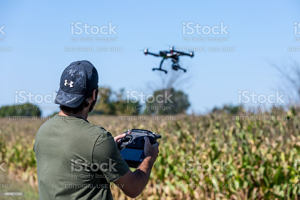 Man Flying a Drone  Over Corn Field stock photo