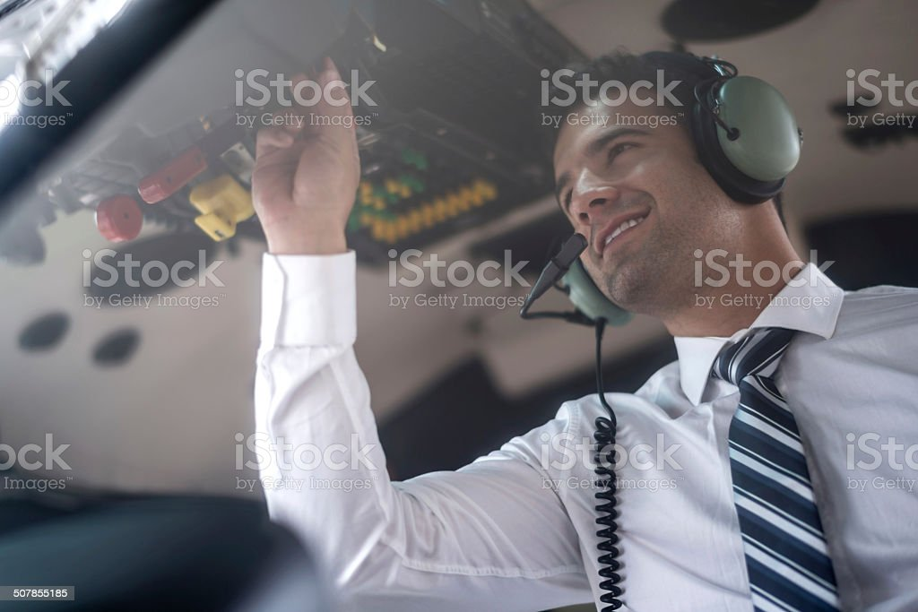 Man flying a helicopter stock photo