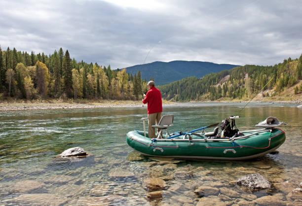 Man Flying Fishing in Driftboat on the Flathead River Montana