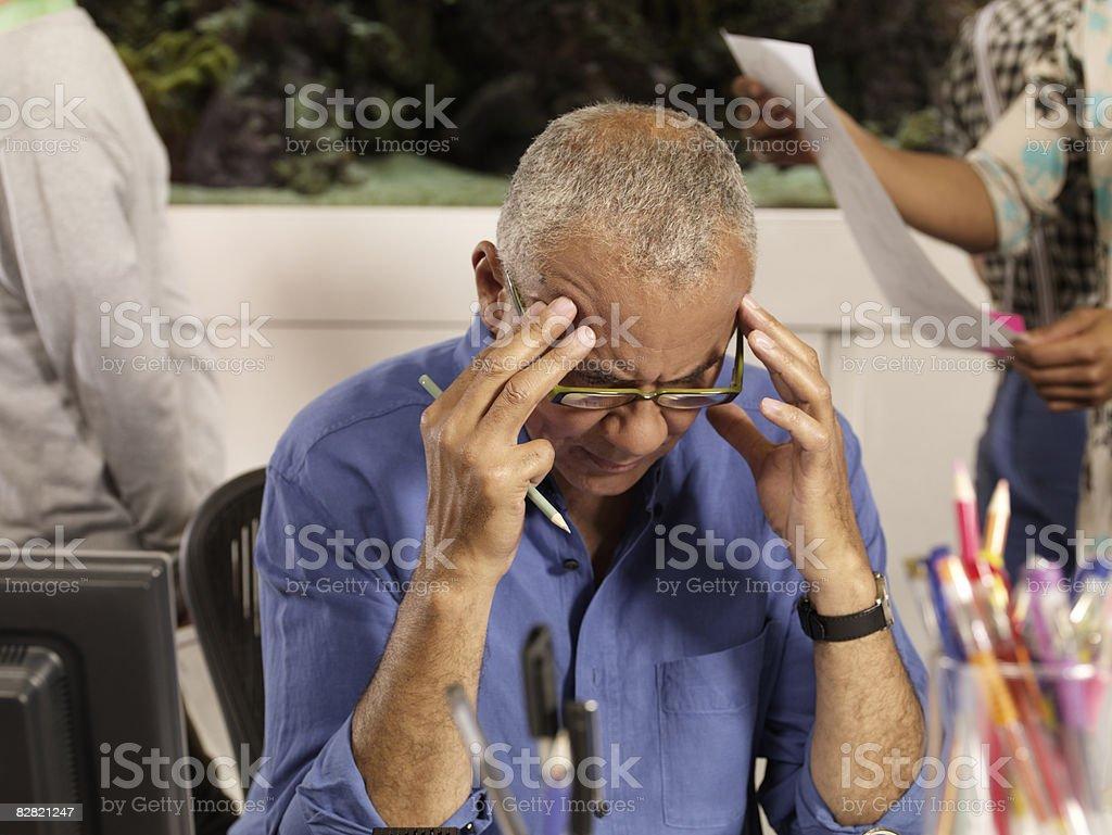 man focusing on his work royalty free stockfoto