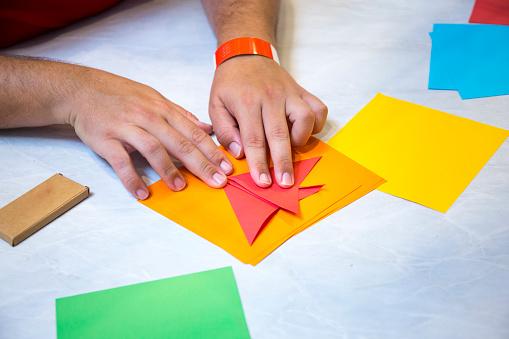 istock A man folding origami paper 1132900308