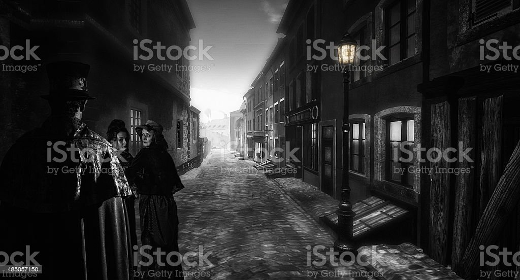 Man following two women in a dark victorian street stock photo