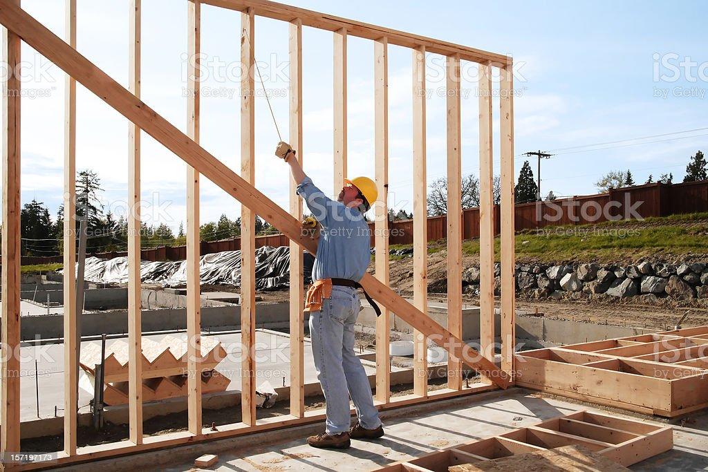 Man framing a wall 'plumb and square' royalty-free stock photo