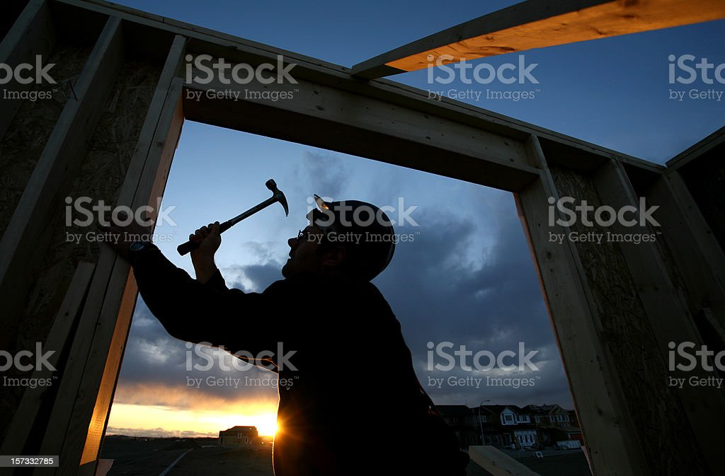 Man Framing Out Window at Residential House royalty-free stock photo