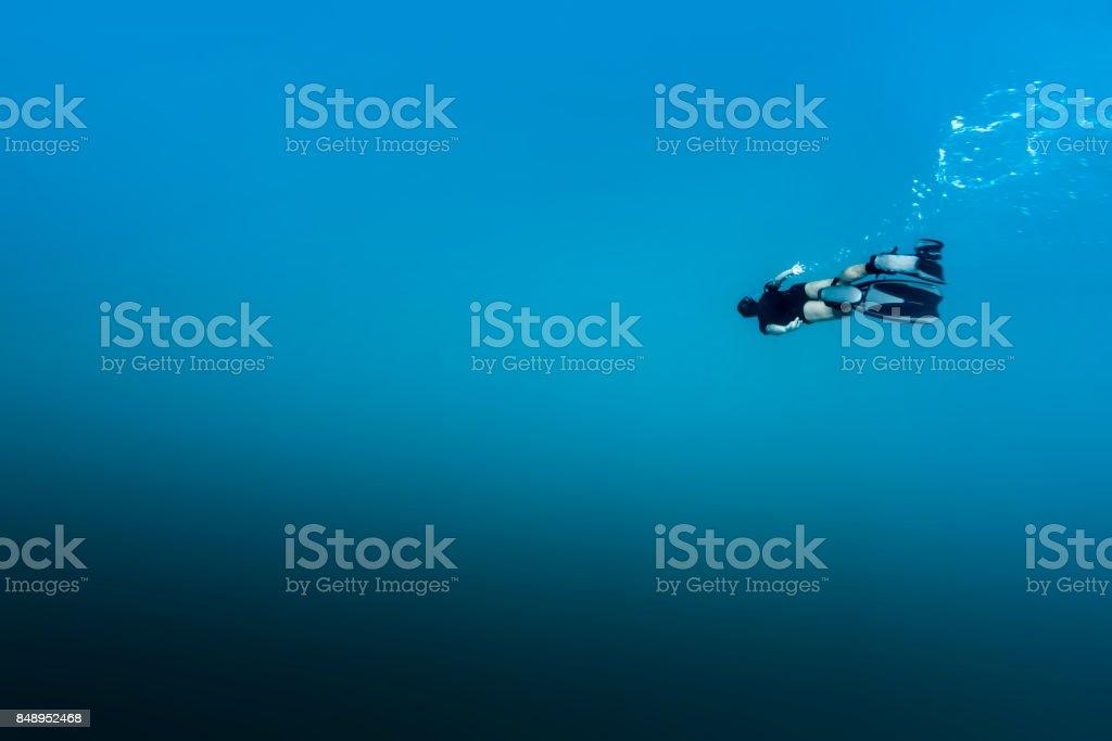 Man free diving in Fernando de Noronha stock photo