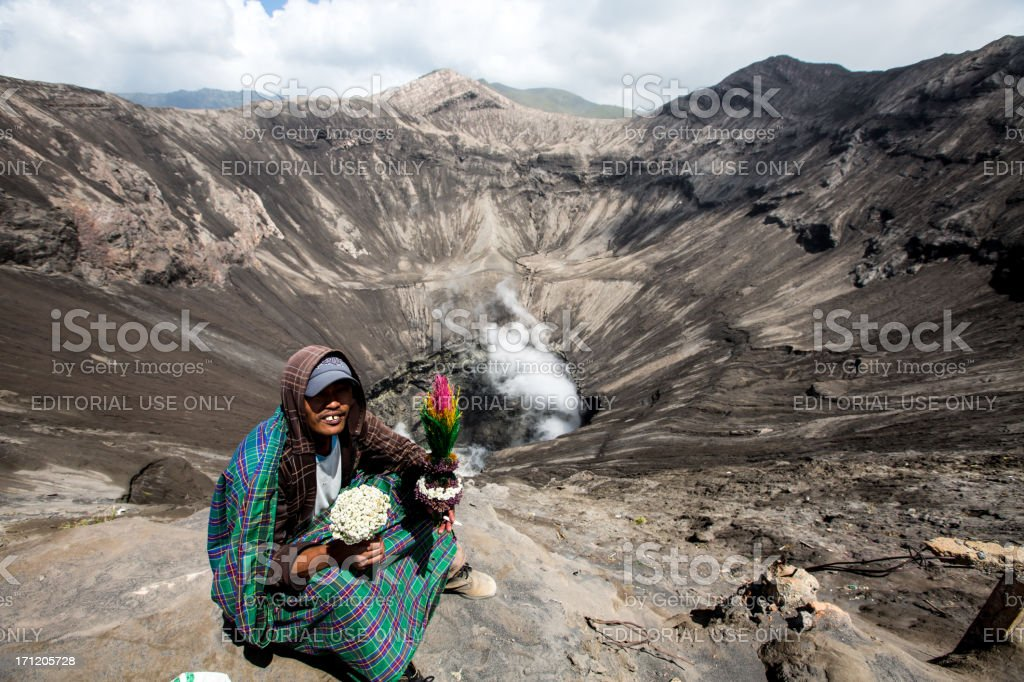 Man from Tengger tribe at the  caldera of Bromo volcano stock photo