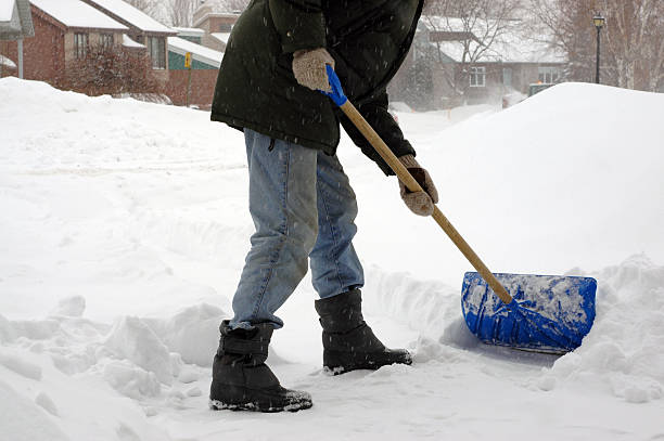 Man from the neck down shoveling snow in a storm picture id94989870?b=1&k=6&m=94989870&s=612x612&w=0&h=rwrjr4pv8rbeicgca94qt5ccsrdirvwkgy45qapv1bg=