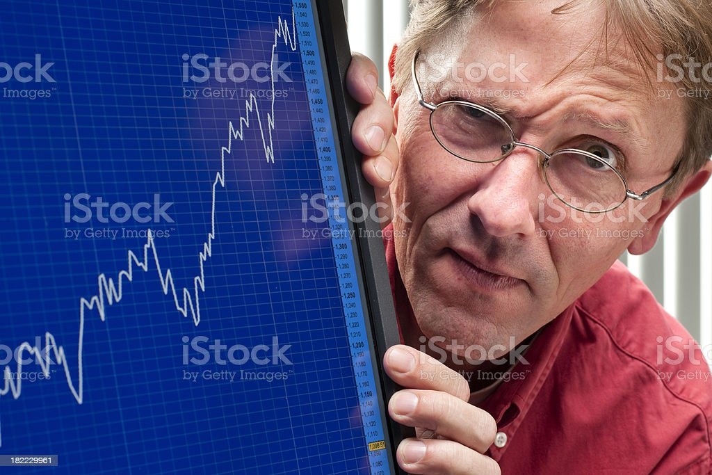 man frowning about positive stock exchange rate XXXL stock photo