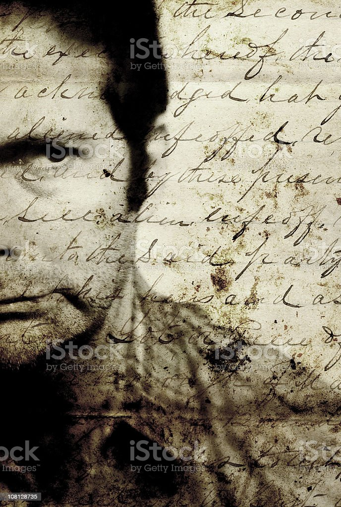 Man Frowning with Old Script on Top of Image royalty-free stock photo