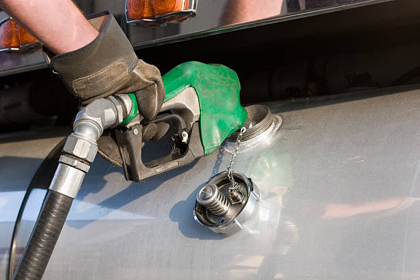A man fuelling up a freight transport truck Diesel Fuel Pump, Semi Truck diesel stock pictures, royalty-free photos & images