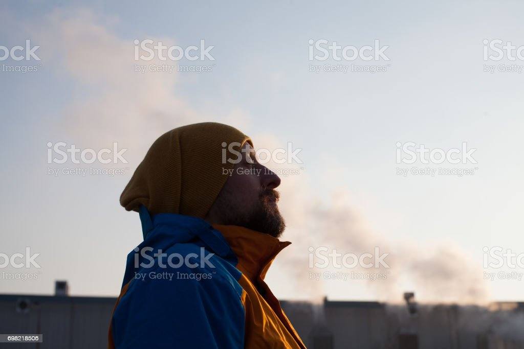 man gasping for air in polluted city stock photo