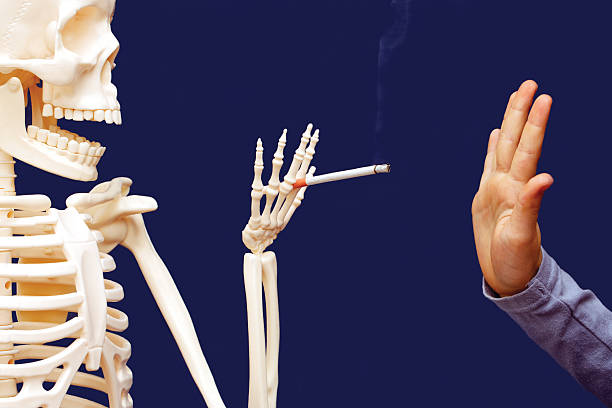 man gesturing disclaims proposed cigarette stock photo