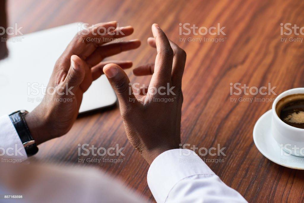 Man gesturing while explaining stock photo