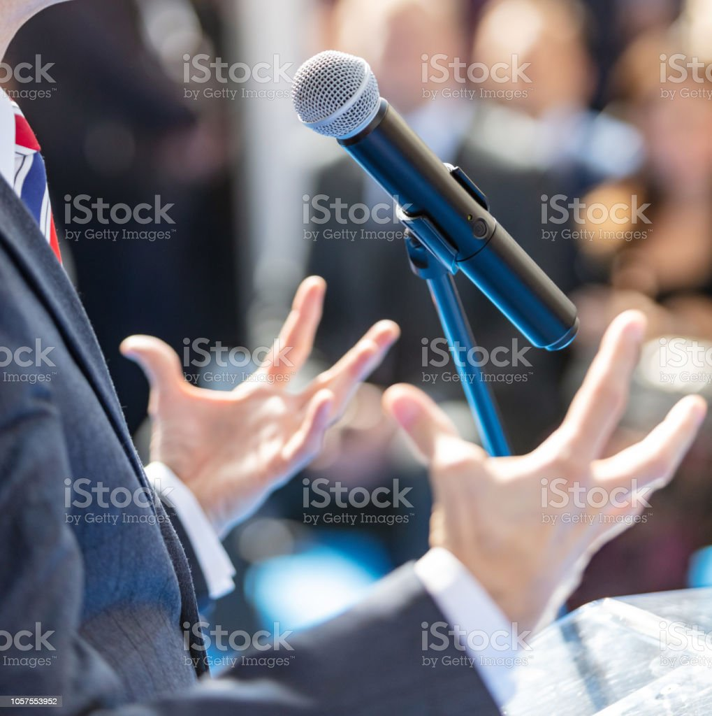 Man Gesturing While Giving Speech Stock Photo - Download