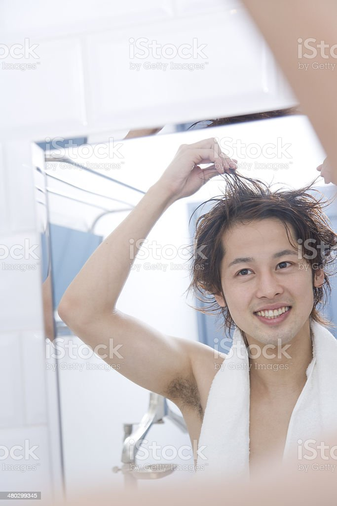 Man gethering wet hair by hand stock photo