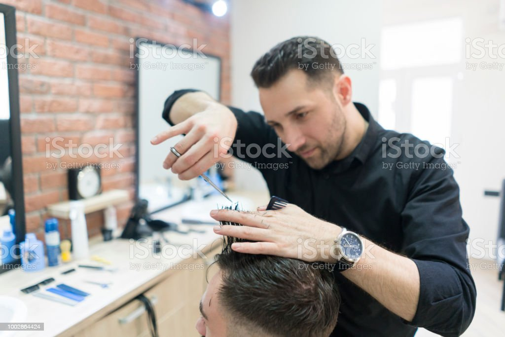 Man Gets A Haircut At His Barber Stock Photo More Pictures Of