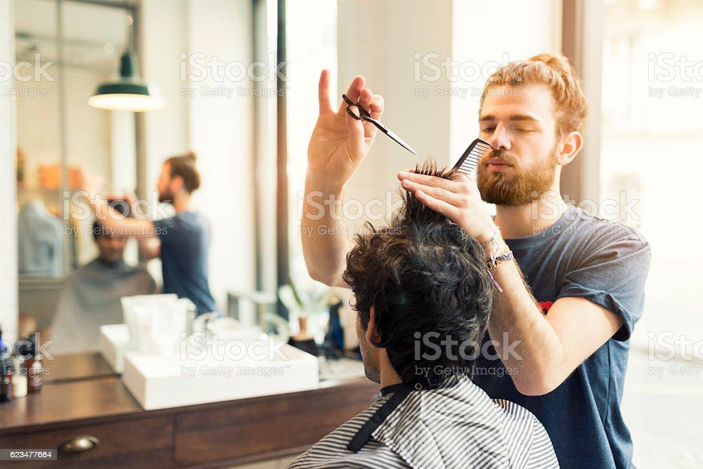 Man gets a haircut at his barber royalty-free stock photo