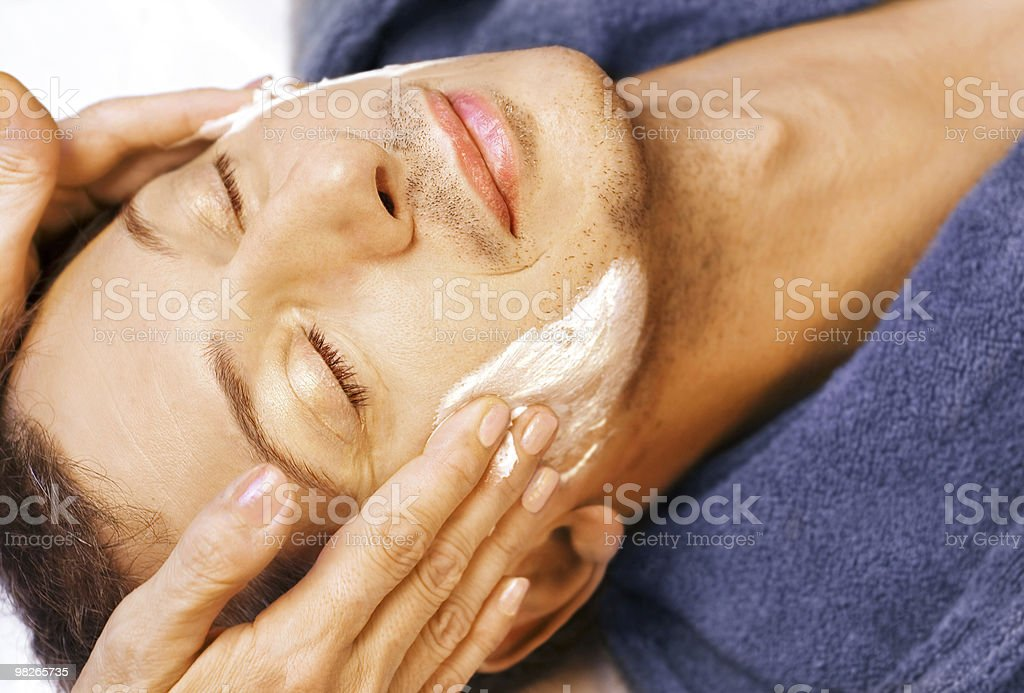 Man gets cream massage on face royalty-free stock photo