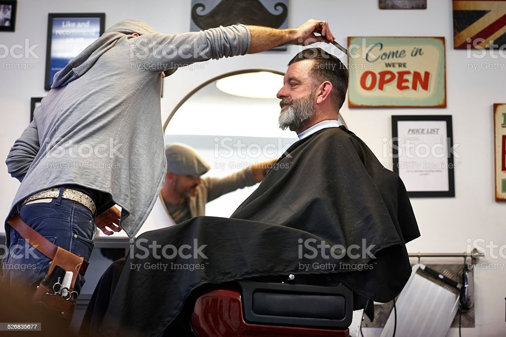 Man getting an haircut from hairstylist stock photo