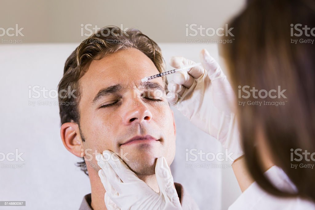 Man getting botulinum toxin stock photo
