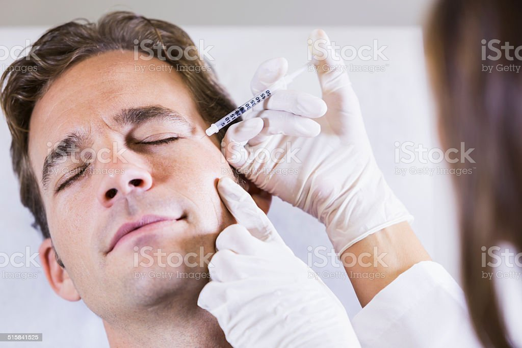 Man getting botulinum toxin stock photo