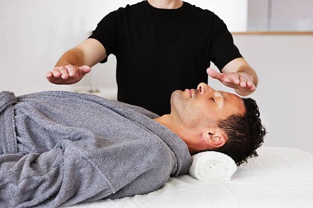 Man Getting Energy Therapy stock photo