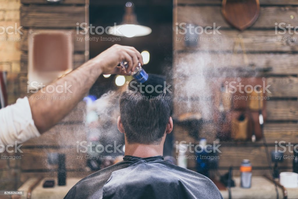man getting hairstyle stock photo