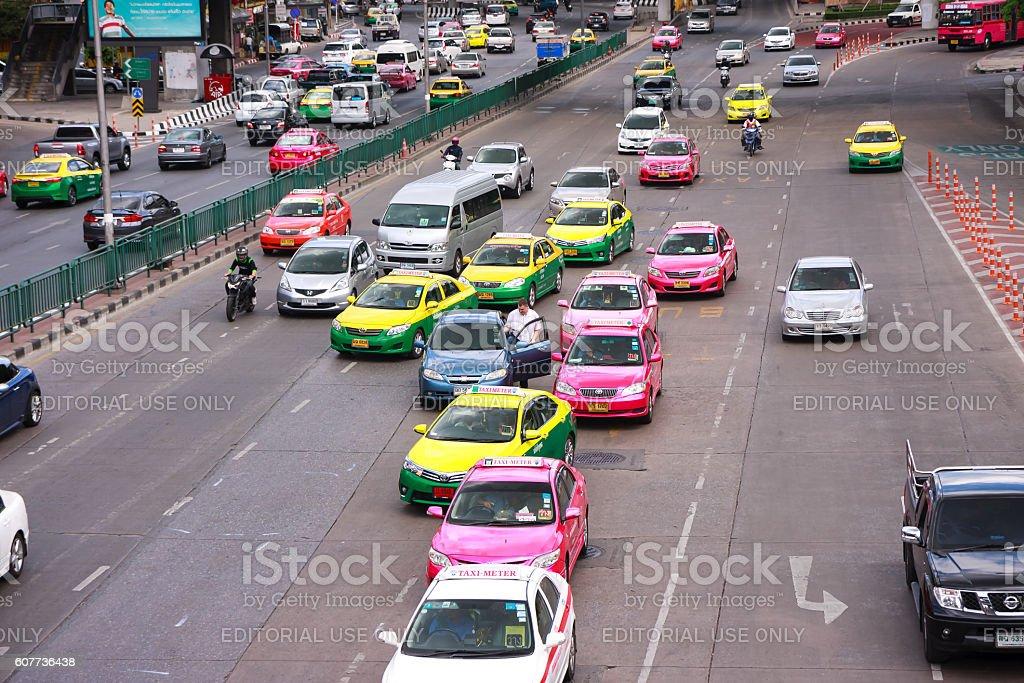 Man getting in car during running traffic stock photo