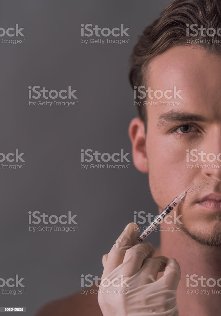 Man getting injection stock photo