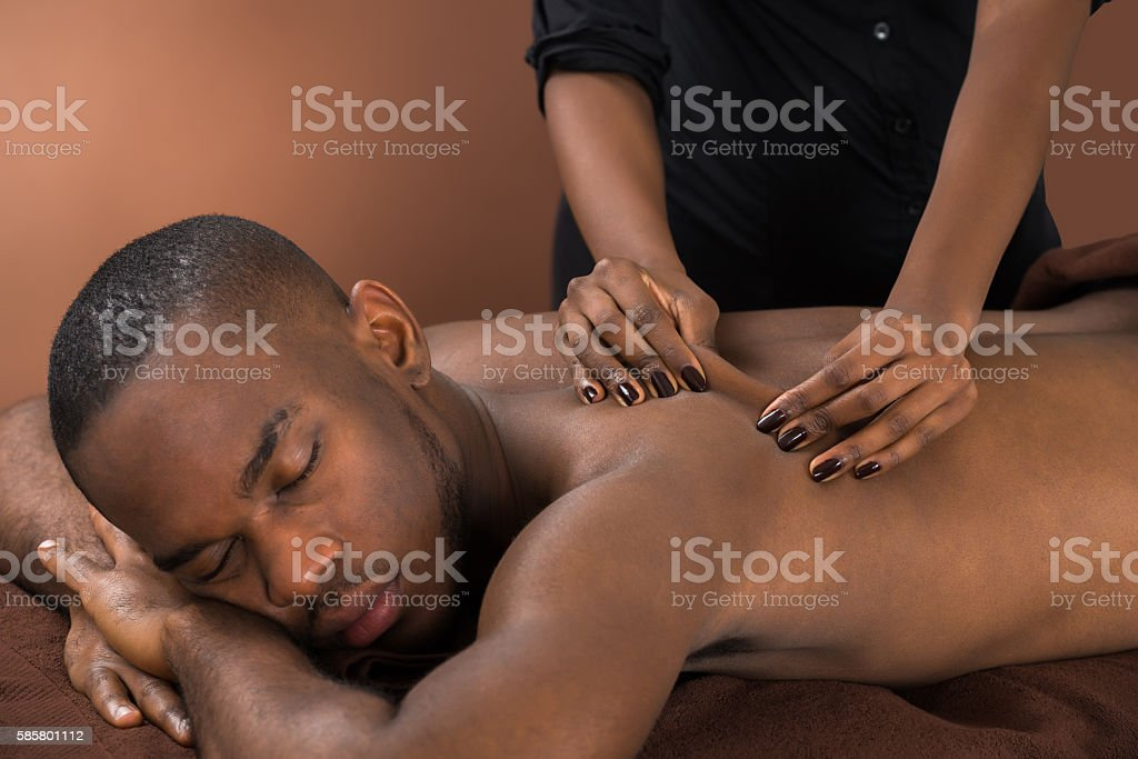 Man Getting Massage In Spa stock photo