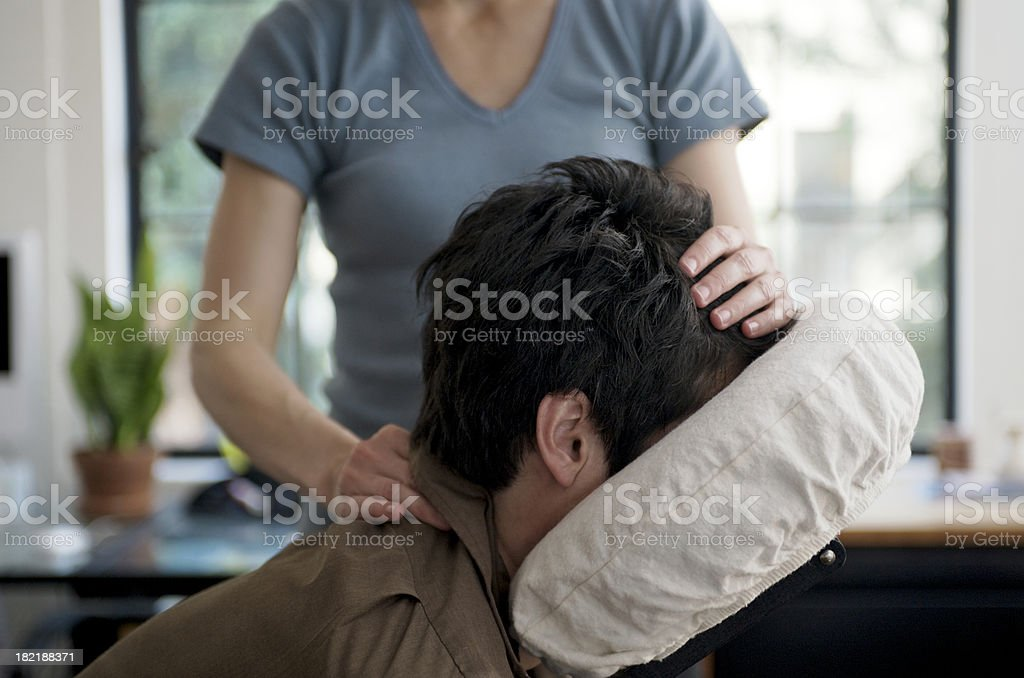 Man Getting Mobile Chair Massage in an Office stock photo
