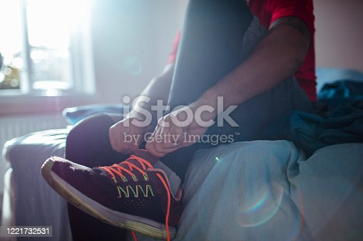 Close up of a young man getting ready for a workout