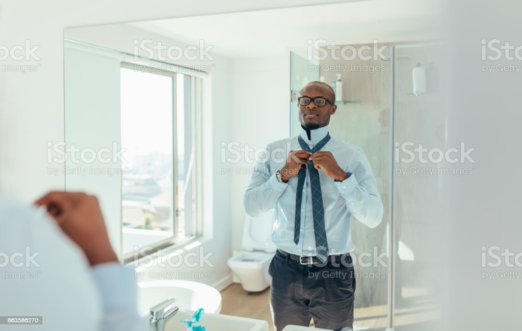 Man getting ready for office stock photo