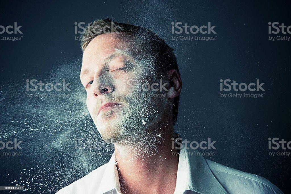 Man getting splashed in flour stock photo