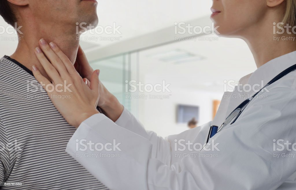 Man getting thyroid gland control. Health care and medical concept stock photo