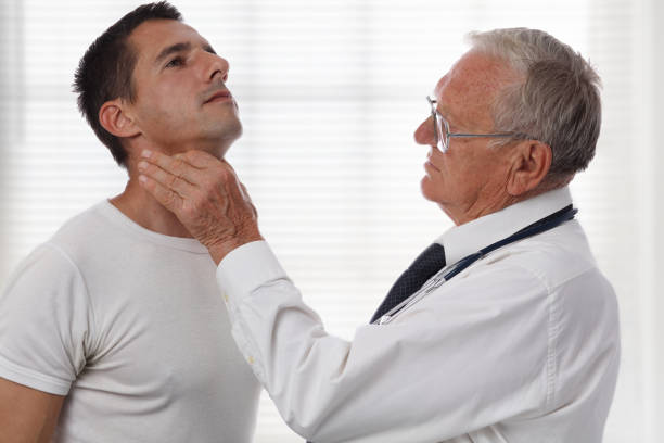 Man getting thyroid gland control. Health care and medical concept. Man getting thyroid gland control. Health care and medical concept. endocrine system stock pictures, royalty-free photos & images
