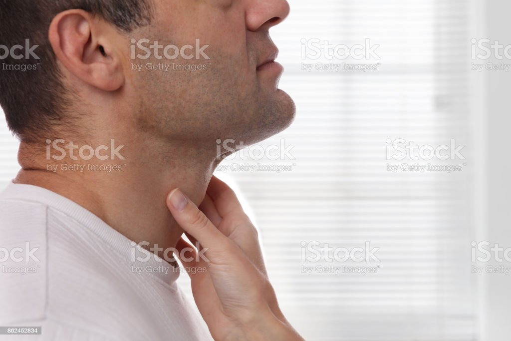 Man getting thyroid gland control. Health care and medical concept. stock photo