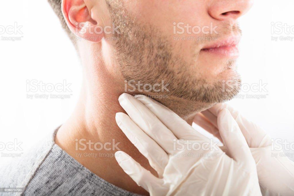 Man Getting Thyroid Gland Control stock photo