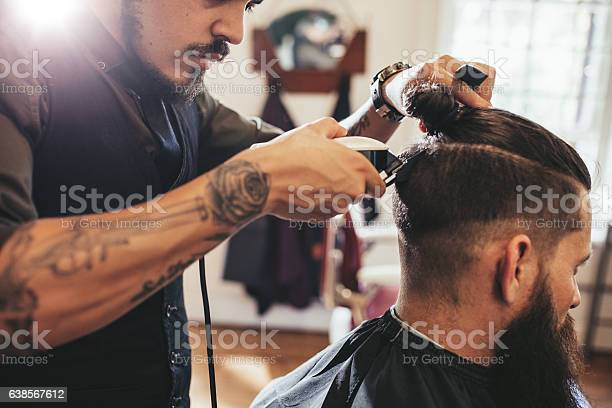 Man Getting Trendy Haircut In Barber Shop Stock Photo - Download Image Now