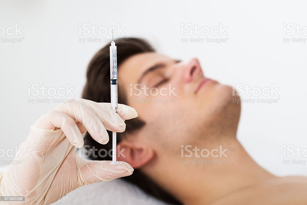 Man Getting Wrinkle Treatment From Doctor stock photo