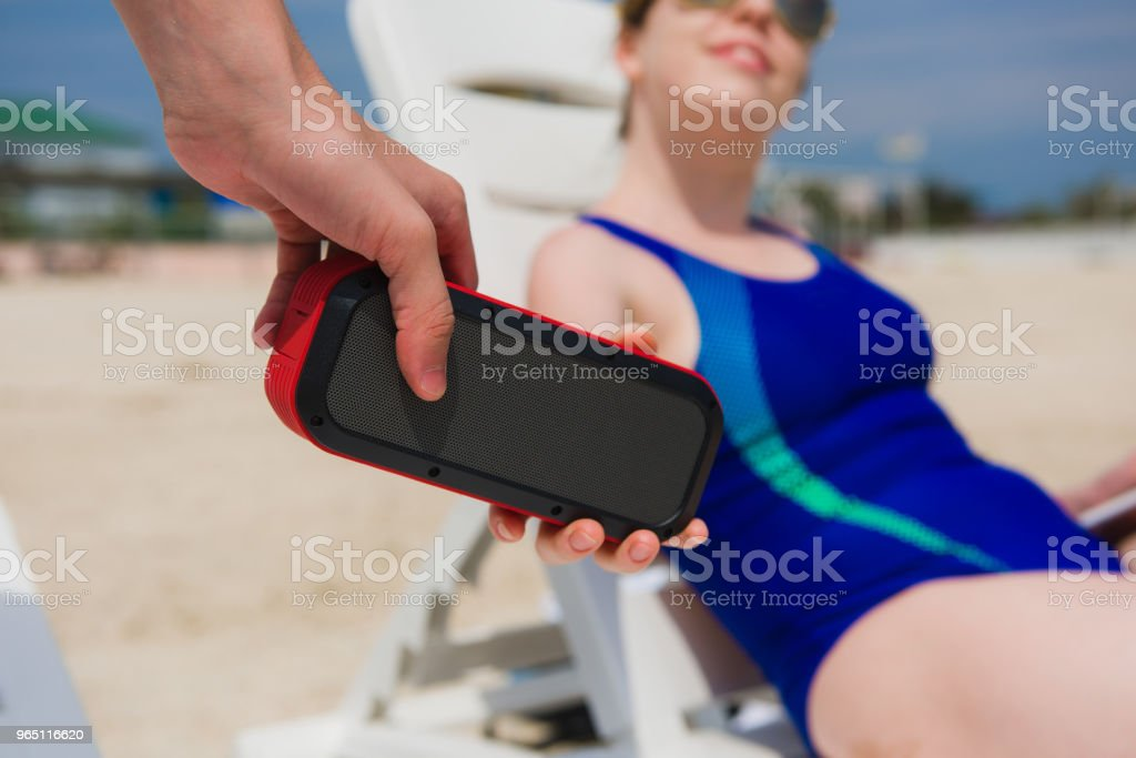 Man give to woman portable speaker royalty-free stock photo
