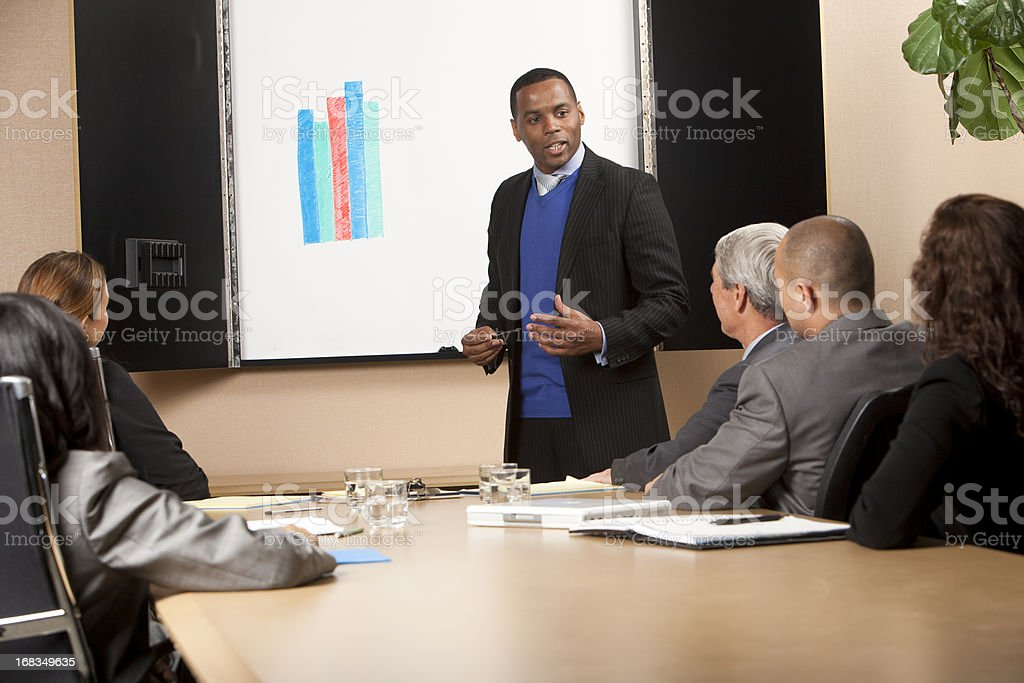 Man gives a presentation to his business colleagues royalty-free stock photo