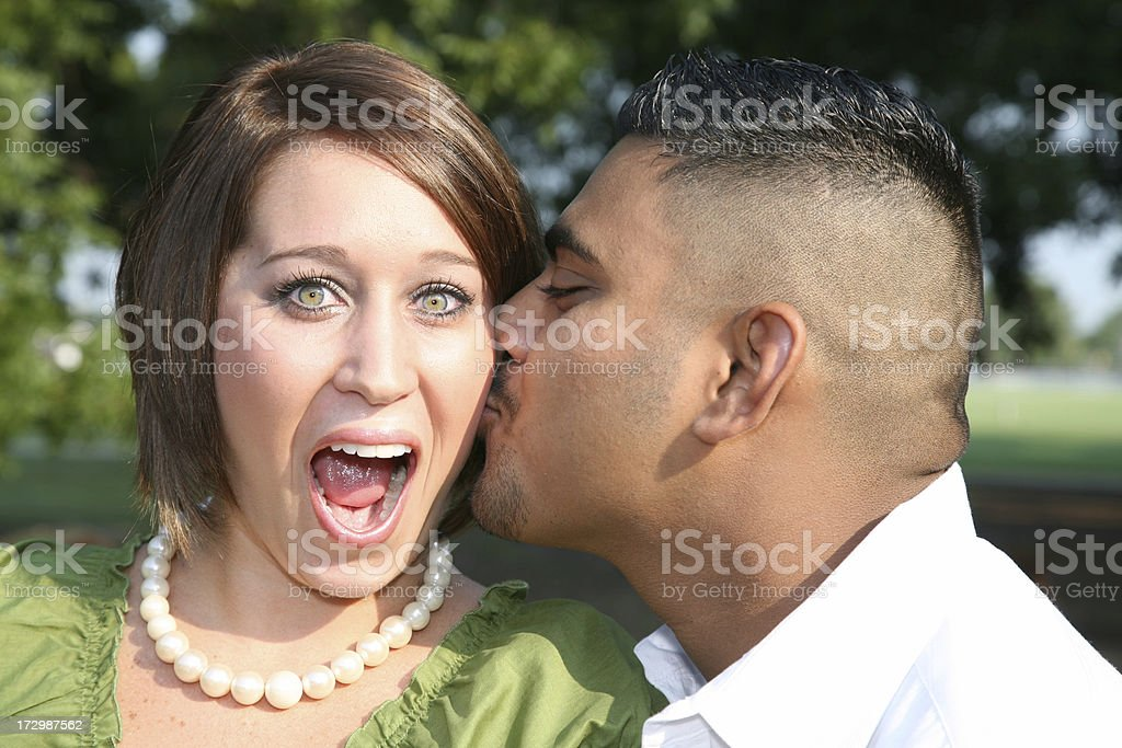 Man Gives His Girl A Surprise Kiss royalty-free stock photo