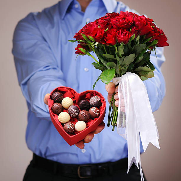 744 Man With Flowers And Chocolate Stock Photos, Pictures & Royalty-Free  Images - iStock
