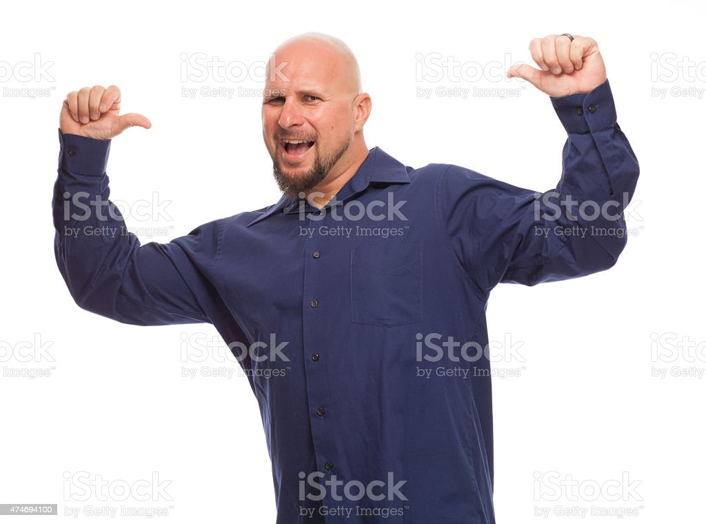 Man giving a thumbs up and looking at camera. stock photo