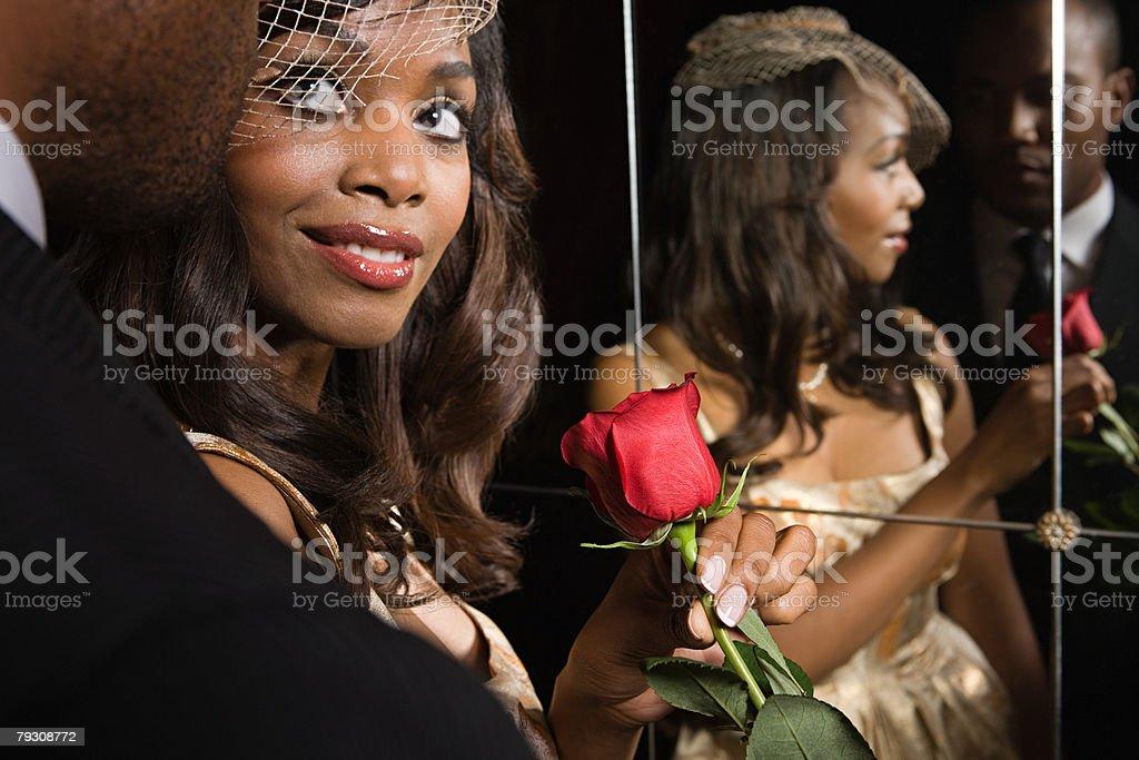 A man giving a woman a rose 免版稅 stock photo